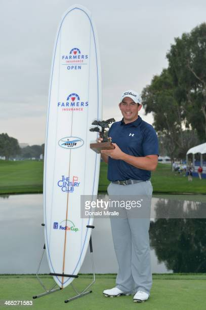 Scott Stallings stands with his trophy after winning the Farmers Insurance Open on Torrey Pines South on January 26 2014 in La Jolla California