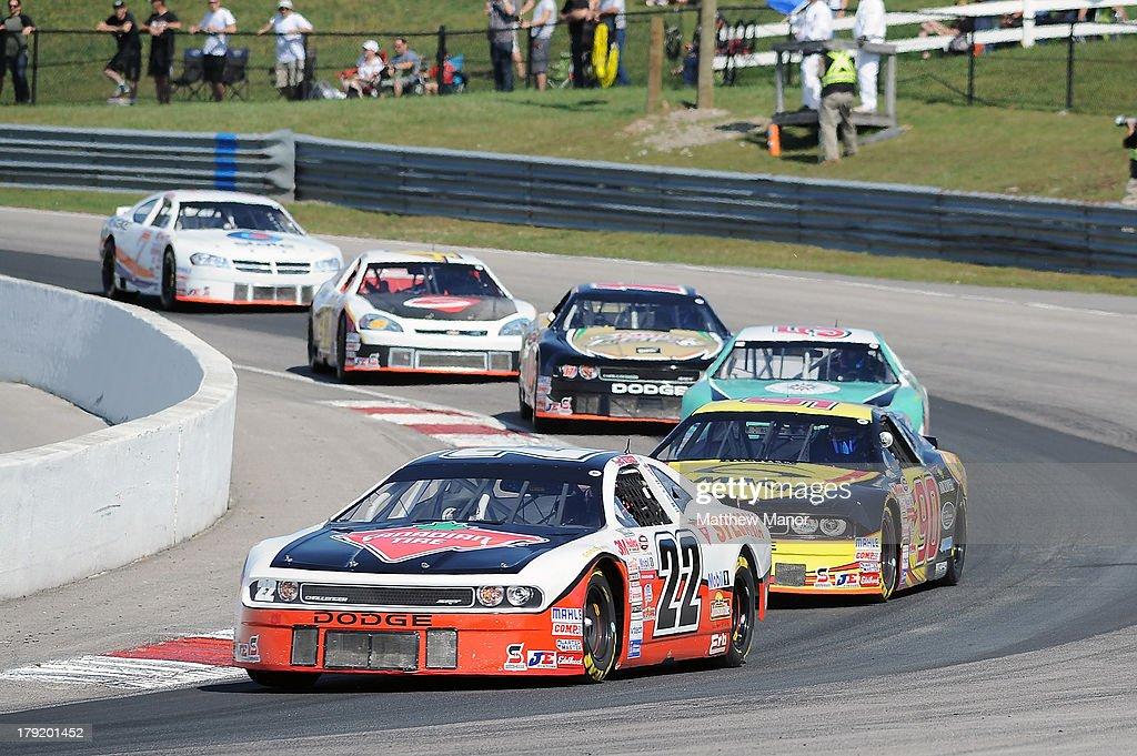 Scott Steckly, driver of the #22 Canadian Tire Dodge races through turn 1 during the NASCAR Canadian Tire Series presented by Mobil 1 Pinty's presents the Clarington 200 at Canadian Tire Motorsport Park on September 1, 2013 in Bowmanville, Canada.