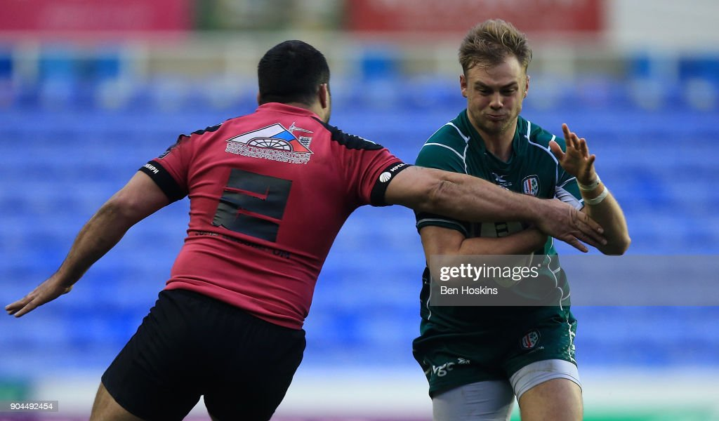 Scott Steele of London Irish is tackled by Valery Tsnobiladze of Krasny Yar during the European Rugby Challenge Cup between London Irish and Krasny Yar on January 13, 2018 in Reading, United Kingdom.