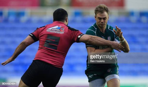 Scott Steele of London Irish is tackled by Valery Tsnobiladze of Krasny Yar during the European Rugby Challenge Cup between London Irish and Krasny...
