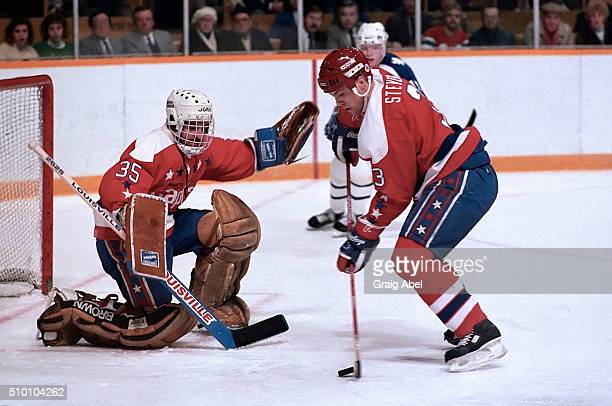 Scott Stevens clears the puck in front of team mate Al Jensen of the Washington Capitals during game action against the Toronto Maple Leafs at Maple...