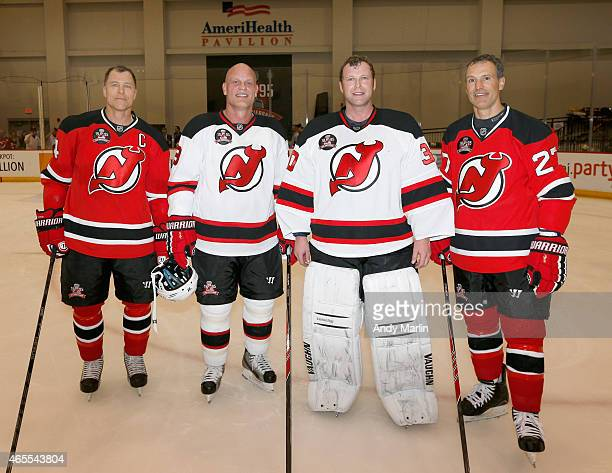 Scott Stevens Ken Daneyko Martin Brodeur and Scott Niedermayer of the New Jersey Devils 1995 Stanley Cup Championship Team pose for a photo during...