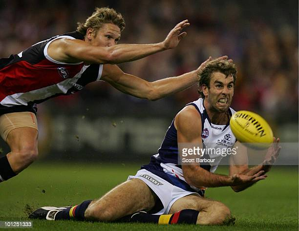 Scott Stevens of the Crows dives to take a mark during the round 10 AFL match between the St Kilda Saints and the Adelaide Crows at Etihad Stadium on...