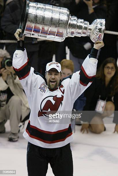 Scott Stevens of the New Jersey Devils holds up the Stanley Cup trophy after defeating the Mighty Ducks of Anaheim 30 in game seven of the 2003...