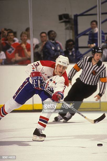 Scott Stevens of the Washington Capitals passes off the puck during a NHL hockey game against the Philadelphia Flyers on March 25 1988 at Capitol...