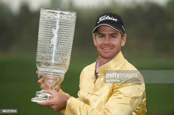 Scott Strange of Australia celebrates with the trophy after winning the final round of the Volvo China Open at the Beijing CBD International Golf...