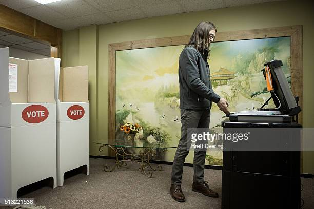 Scott Stuckey of Oklahoma City feeds a ballot into an optical scanner at Trinity Baptist Church on Super Tuesday March 1 2016 in Oklahoma City...