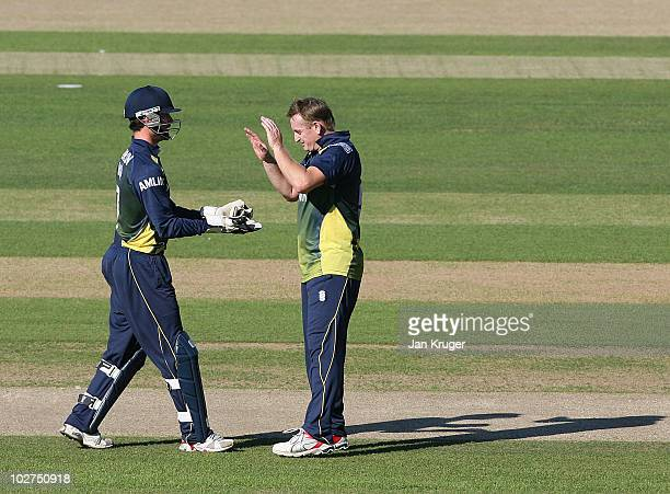 Scott Styris and James Foster of Essex celebrate a wicket during the Friends Provident T20 match between Kent and Essex at The Brit Oval on July 9...