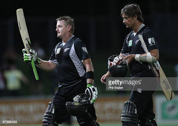 Scott Styris and Shane Bond of New Zealand leave the field following the First One Day International match between New Zealand and Australia at...