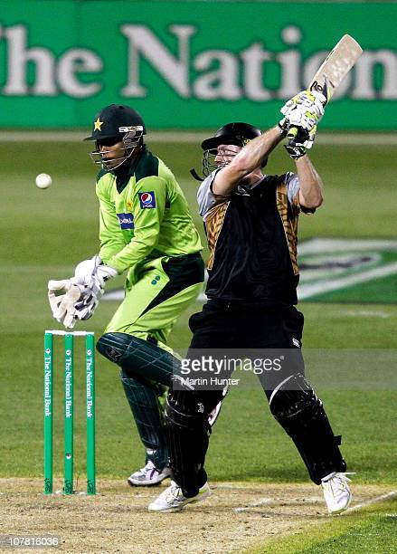 Scott Styris of New Zealand hits out as Umar Akmal of Pakistan looks on during game three of the Twenty20 series between New Zealand and Pakistan at...