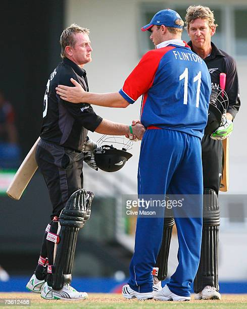 Scott Styris of New Zealand shakes hands with Andrew Flintoff of England as Jacob Oram looks on during the ICC Cricket World Cup Group C match...