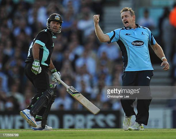 Scott Styris of Sussex celebrates taking the wicket of Jason Roy of Surrey as Ricky Pointing of Surrey watches during the Friends Life T20 match...