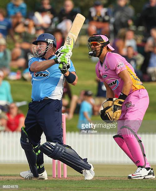 Scott Styris of the Auckland Aces bats in front of wicketkeeper Peter McGlashan of the Northern Knights during the HRV Twenty20 Cup match between the...
