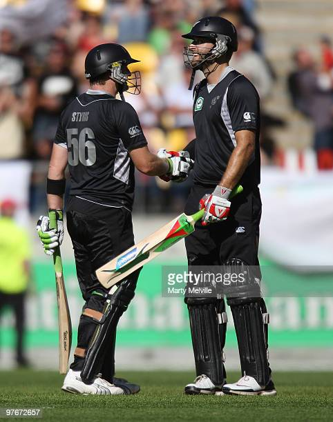 Scott Styris of the Blackcaps is congratulated for his 50 runs by captain Daniel Vettori hits the ball during the 5th ODI match between New Zealand...
