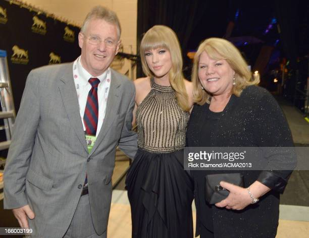 Scott Swift singer Taylor Swift and Andrea Swift attend the 48th Annual Academy of Country Music Awards at the MGM Grand Garden Arena on April 7 2013...