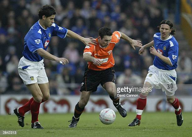 Scott Taylor of Blackpool battles with Dejan Stefanovic of Portsmouth during the FA Cup Third Round match between Portsmouth and Blackpool at Fratton...