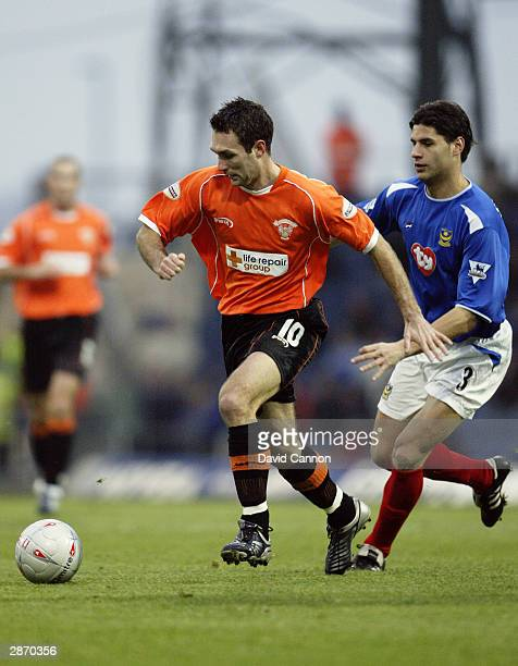 Scott Taylor of Blackpool breaks away from Dejan Stefanovic of Portsmouth during the FA Cup third round match between Portsmouth and Blackpool on...
