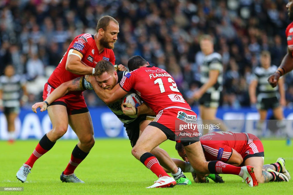Scott Taylor of Hull FC is tackled by Mark Flanagan and Daniel Murray during the Betfred Super League match between Hull FC and Salford Red Devils at KCOM Stadium on June 8, 2018 in Hull, England.
