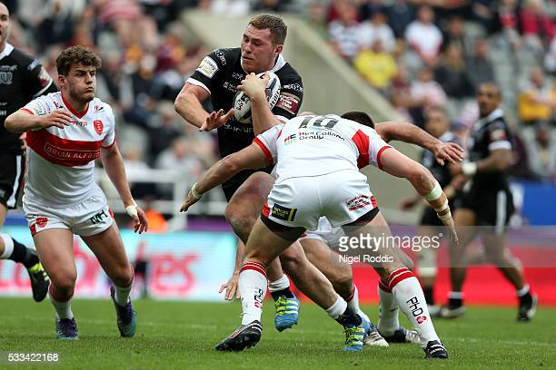 Scott Taylor of Hull FC tackled by Mitch Allgood of Hull KR during the First Utility Super League match between Hull FC and Hull KR at St James' Park...