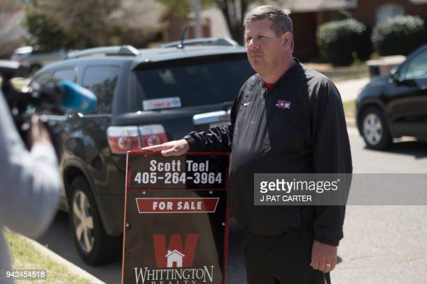 Scott Teel a high school history teacher posts a 'for sale' sign as part of his second job as a real estate agent in Moore Oklahoma on April 4 2018...
