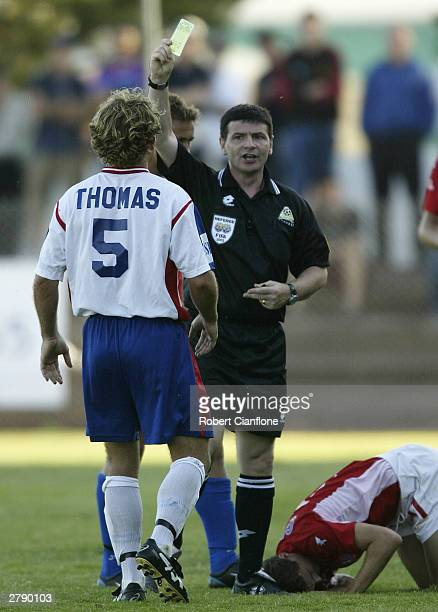 Scott Thomas of United is shown the yellow card by referee Eddie Lennie during the round 12 NSL match between the Melbourne Knights and Newcastle...