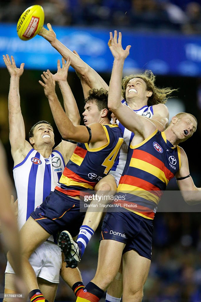 Scott Thompson and Ben Brown of the Kangaroos compete for the ball with Mitchell McGovern and Sam Jacobs of the Crows during the round one AFL match between the North Melbourne Kangaroos and the Adelaide Crows at Etihad Stadium on March 26, 2016 in Melbourne, Australia.