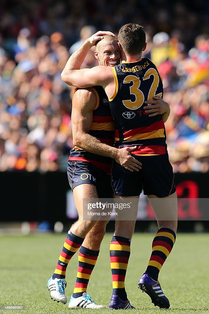 Scott Thompson and Patrick Dangerfield of the Crows celebrate a goal by Dangerfield during the round five AFL match between the Adelaide Crows and the Greater Western Sydney Giants at Adelaide Oval on April 20, 2014 in Adelaide, Australia.