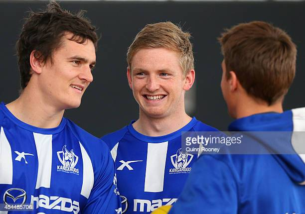 Scott Thompson Jack Ziebell and Andrew Swallow of the Kangaroos chat during a North Melbourne Kangaroos AFL media session at Arden Street Ground on...