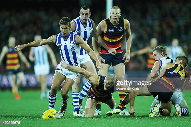 Scott Thompson of the Crows competes for the ball with Andrew Swallow of the Kangaroos during the round 13 AFL match between the Adelaide Crows and...