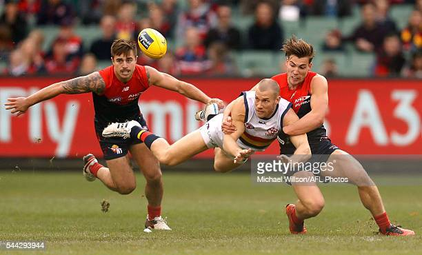 Scott Thompson of the Crows is tackled by Jack Viney of the Demons during the 2016 AFL Round 15 match between the Melbourne Demons and the Adelaide...