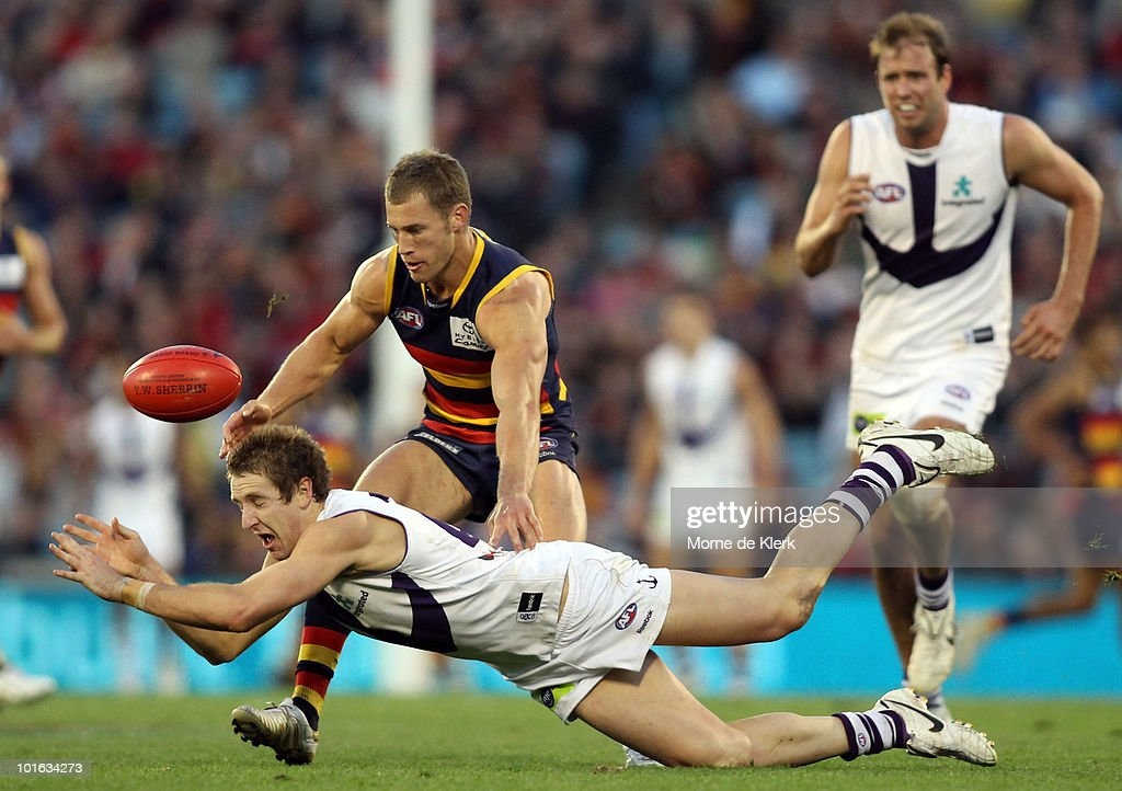 Scott Thompson of the Crows puts pressure on Michael Barlow of the Dockers during the round 11 AFL match between the Adelaide Crows and the Fremantle Dockers at AAMI Stadium on June 5, 2010 in Adelaide, Australia.