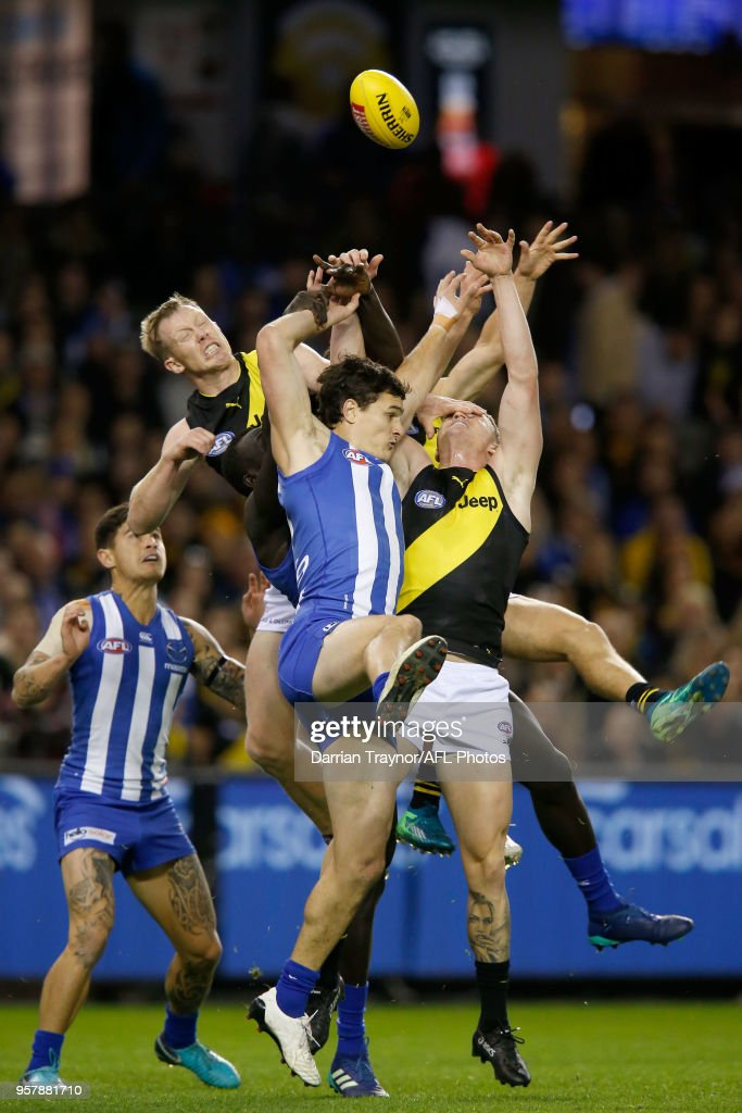 Scott Thompson of the Kangaroos and Jack Riewoldt of the Tigers jump for the ball during the round eight AFL match between the North Melbourne Kangaroos and the Richmond Tigers at Etihad Stadium on May 13, 2018 in Melbourne, Australia.