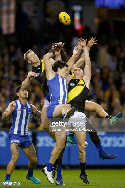 Scott Thompson of the Kangaroos and Jack Riewoldt of the Tigers jump for the ball during the round eight AFL match between the North Melbourne...