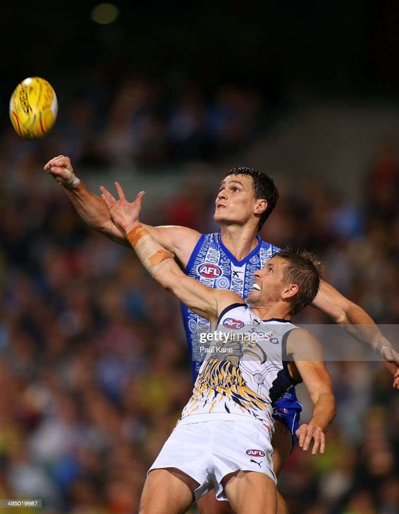 Scott Thompson of the Kangaroos and Mark LeCras of the Eagles contest a mark during the round 11 AFL match between the West Coast Eagles and the North Melbourne Kangaroos at Patersons Stadium on June 1, 2014 in Perth, Australia.
