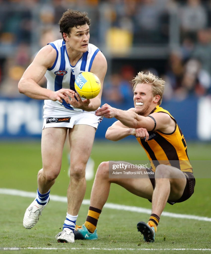 Scott Thompson of the Kangaroos and Will Langford of the Hawks compete for the ball during the 2017 AFL round 21 match between the Hawthorn Hawks and the North Melbourne Kangaroos at the University of Tasmania Stadium on August 13, 2017 in Launceston, Australia.