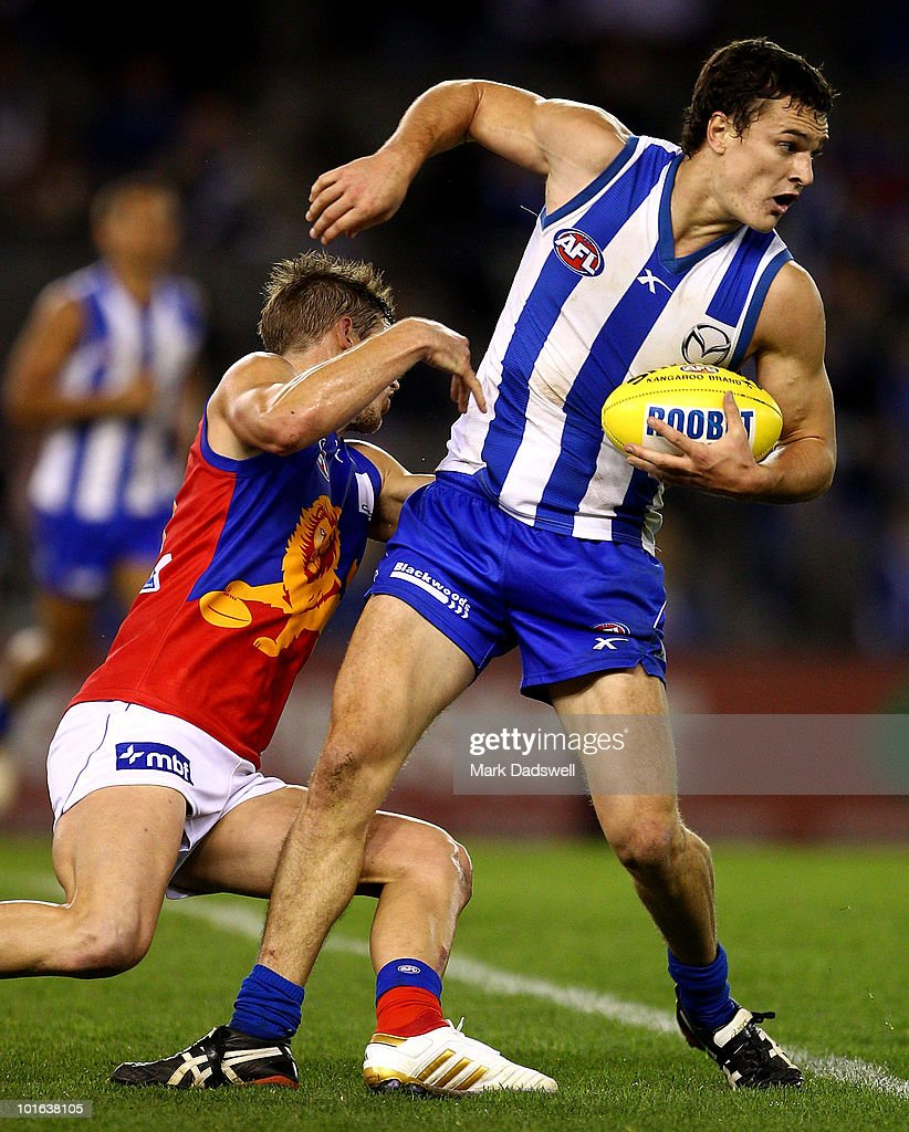 Scott Thompson of the Kangaroos brushes off a tackle during the round 11 AFL match between the North Melbourne Kangaroos and the Brisbane Lions at Etihad Stadium on June 5, 2010 in Melbourne, Australia.