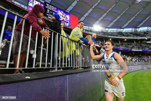 Scott Thompson of the Kangaroos celebrates with the fans during the 2018 AFL round 10 match between the Fremantle Dockers and the North Melbourne...