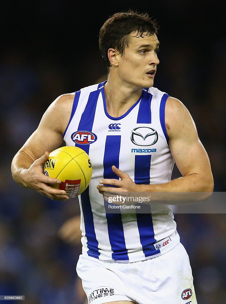 Scott Thompson of the Kangaroos controls the ball during the round six AFL match between the North Melbourne Kangaroos and the Western Bulldogs at Etihad Stadium on April 29, 2016 in Melbourne, Australia.