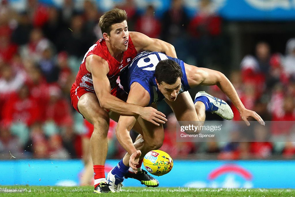 Scott Thompson of the Kangaroos is tackled by Jake Lloyd of the Swans during the round 10 AFL match between the Sydney Swans and the North Melbourne Kangaroos at Sydney Cricket Ground on May 27, 2016 in Sydney, Australia.