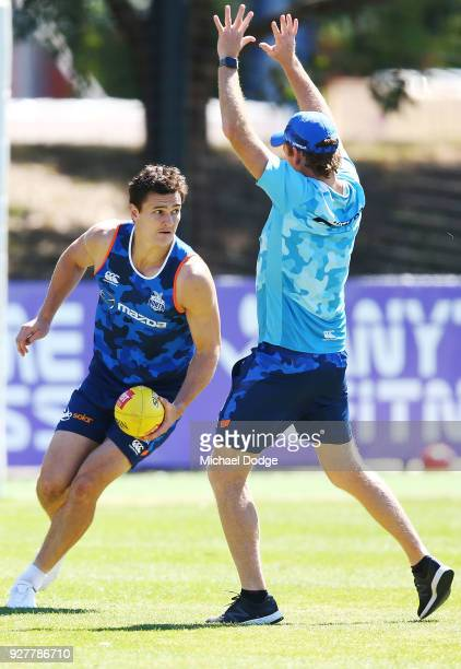 Scott Thompson of the Kangaroos looks upfield during a North Melbourne Kangaroos AFL training session at Arden Street Ground on March 6 2018 in...