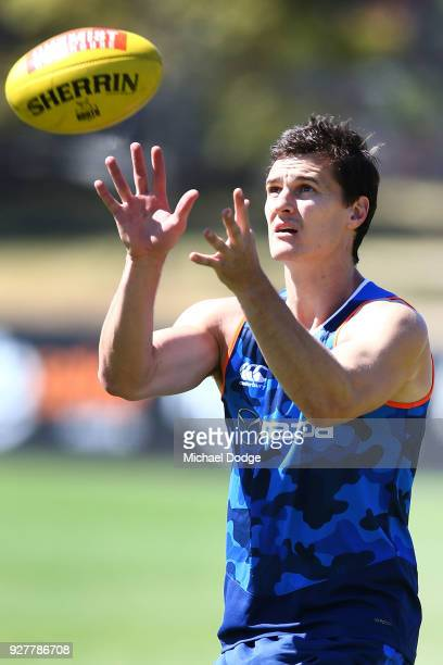 Scott Thompson of the Kangaroos marks the ball during a North Melbourne Kangaroos AFL training session at Arden Street Ground on March 6 2018 in...