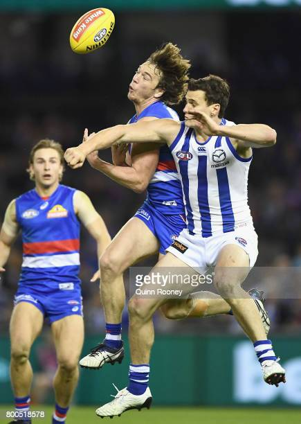 Scott Thompson of the Kangaroos spoils a mark by Liam Picken of the Bulldogs during the round 14 AFL match between the Western Bulldogs and the North...