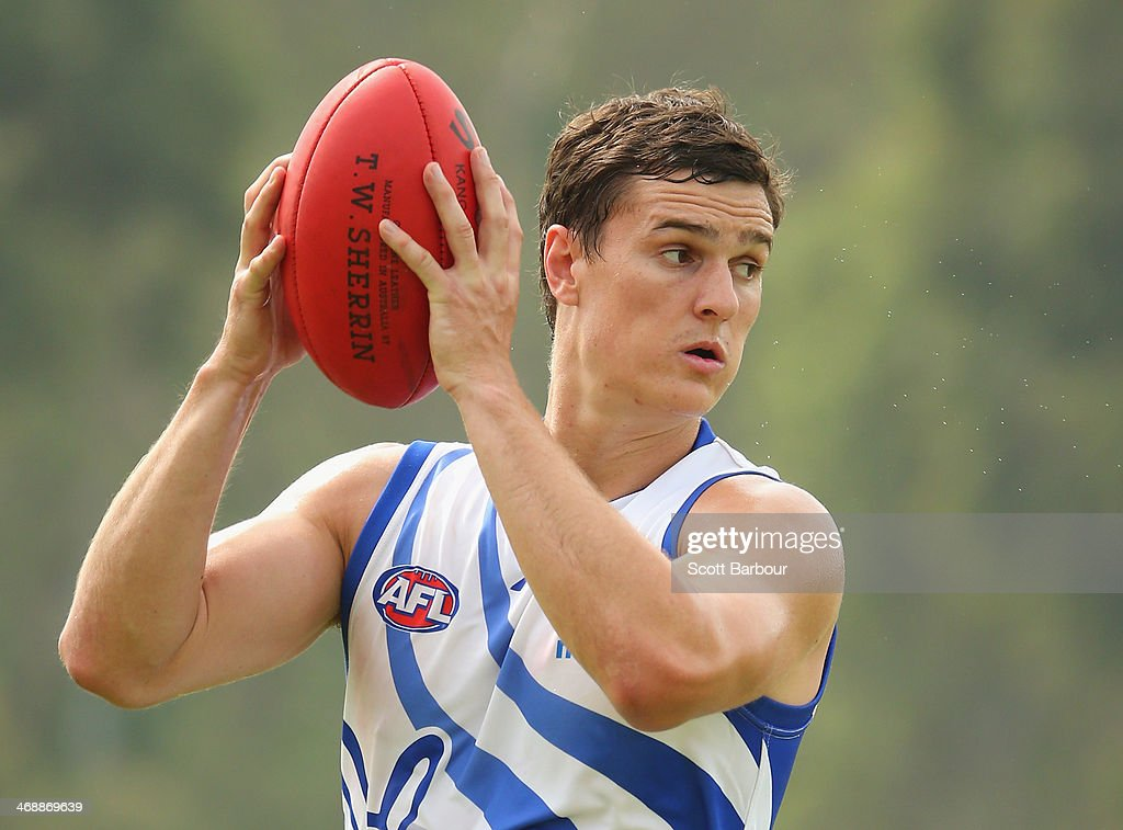Scott Thompson runs with the ball during a North Melbourne Kangaroos AFL training session at Aegis Park on February 12, 2014 in Melbourne, Australia.