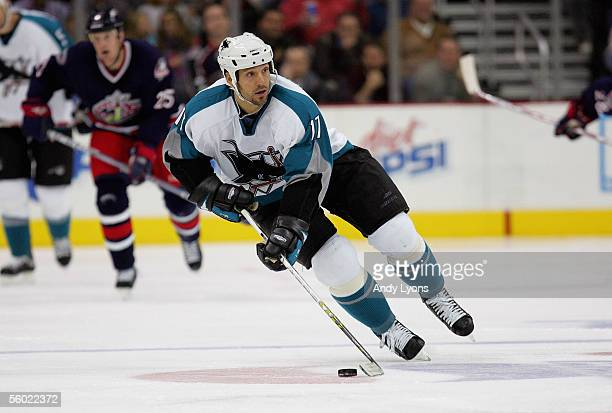 Scott Thornton of the San Jose Sharks skates the puck through the neutral zone against the Columbus Blue Jackets during their NHL game at Nationwide...