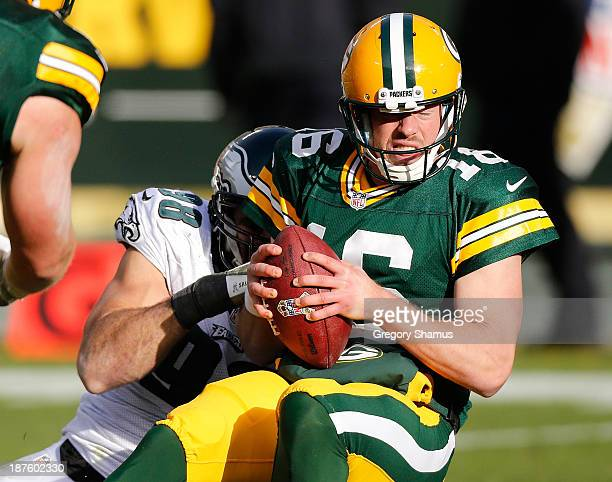 Scott Tolzien of the Green Bay Packers is sacked by Connor Barwin of the Philadelphia Eagles during the third quarter at Lambeau Field on November 10...