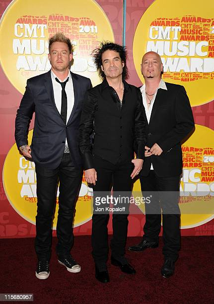 Scott Underwood Pat Monahan and Jimmy Stafford of the Band Train attend the 2011 CMT Music Awards at the Bridgestone Arena on June 8 2011 in...