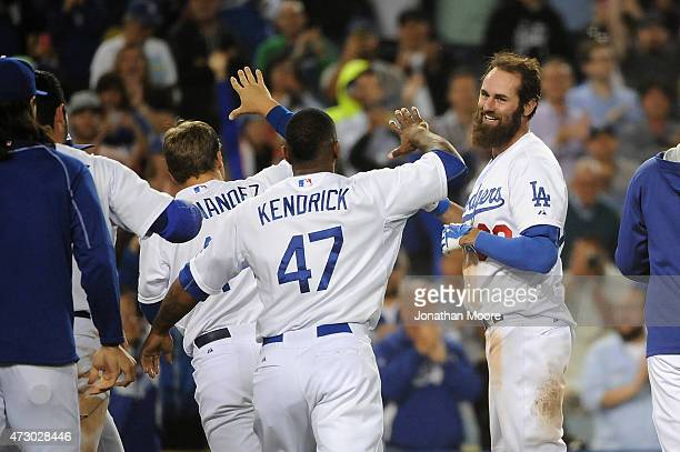 Scott Van Slyke of the Los Angeles Dodgers celebrates after hitting a walk off three run home run at the bottom of the ninth inning during a game...