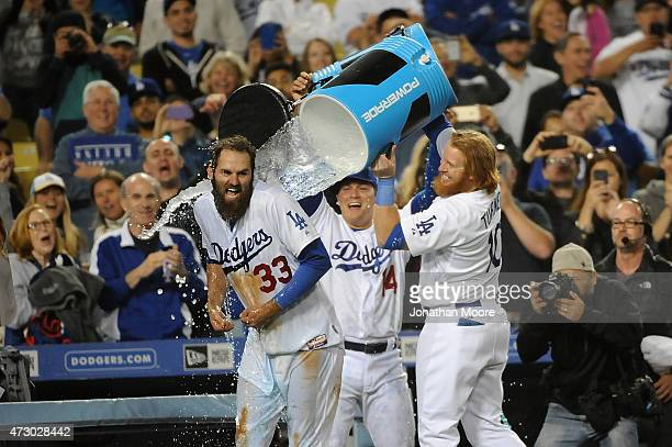 Scott Van Slyke of the Los Angeles Dodgers celebrates with Enrique Hernandez and Justin Turner after hitting a walk off three run home run at the...