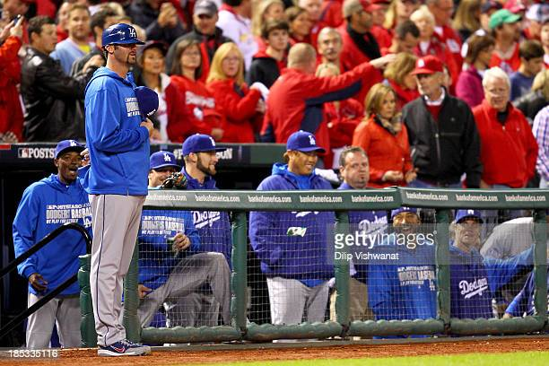 Scott Van Slyke of the Los Angeles Dodgers stands on the field across from Joe Kelly of the St Louis Cardinals before the start of Game Six of the...