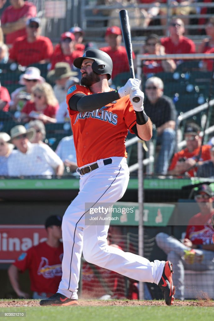 Scott Van Slyke #5 of the Miami Marlins hits a solo home run against the St Louis Cardinals during the sixth inning of a spring training game at Roger Dean Chevrolet Stadium on February 23, 2018 in Jupiter, Florida. The Marlins defeated the Cardinals 6-4.